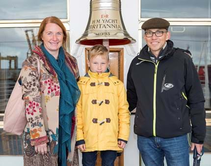 Visitors pose next to the iconic Britannia Bell, a popular spot for photographs!