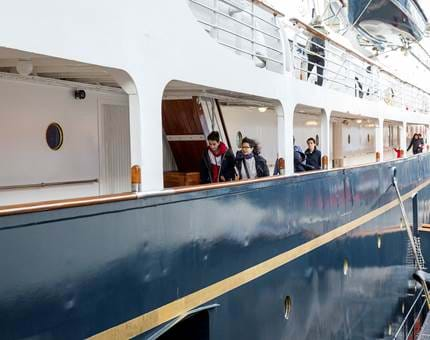 Visitors exploring the Royal Yacht with their audio handset.