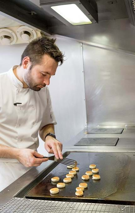 Michal, Junior Sous Chef, making buckwheat blinis for hot smoked salmon canapés.