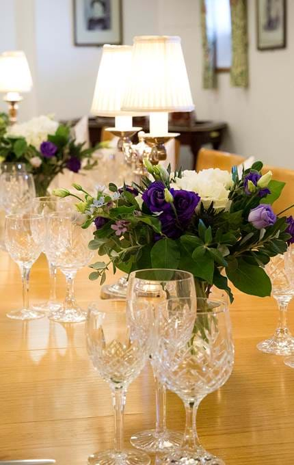 Beautiful fresh flower displays adorn the Officers' Wardroom table.