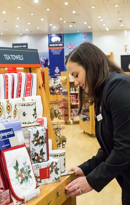 Kirsty, Shop Manager, tends to our Christmas display in the Gift Shop.