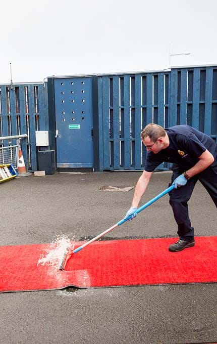 staff cleaning red carpet royal yacht britannia