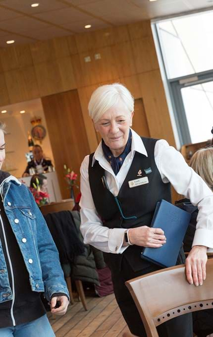waitress with guest royal yacht britannia
