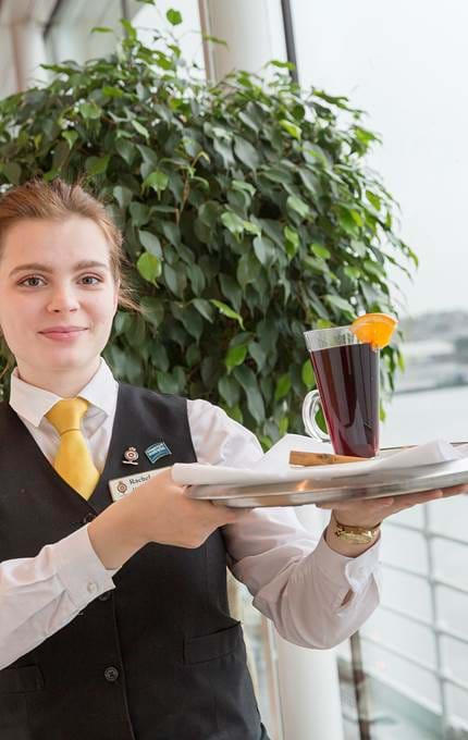 waitress with drink on platter royal yacht britannia