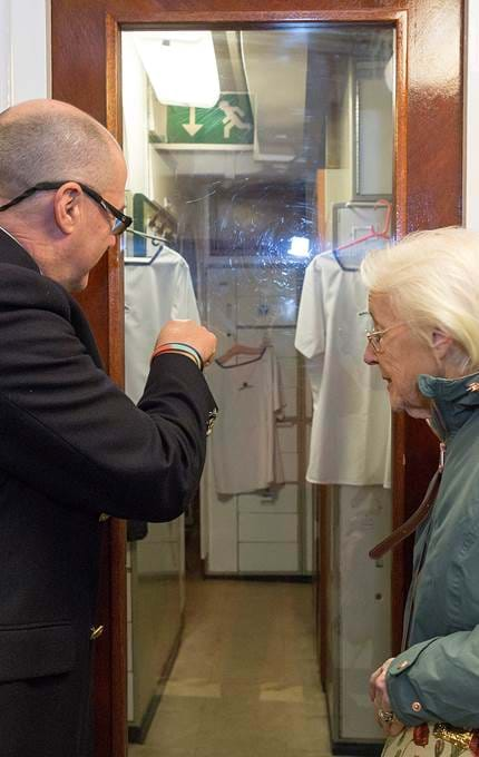 host showing guest a room royal yacht britannia