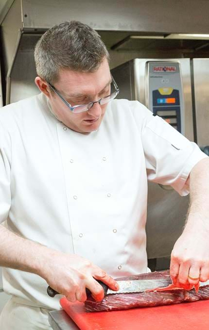 chef slicing meat royal yacht britannia