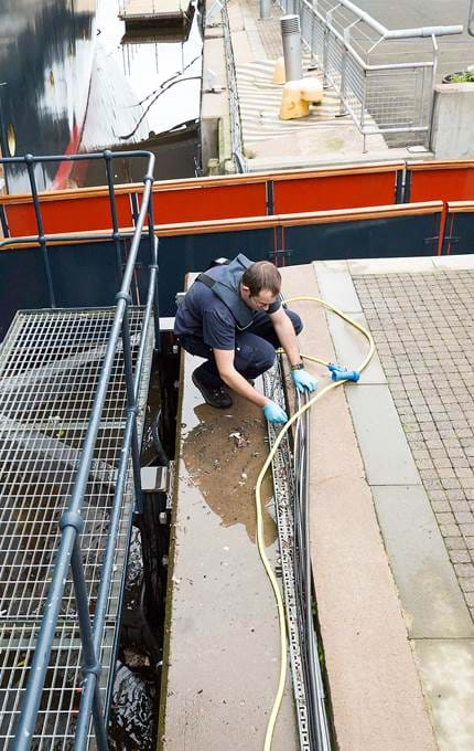 staff cleaning outside royal yacht britannia