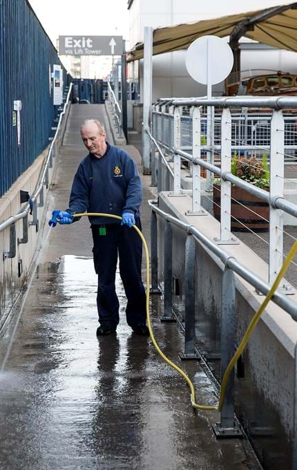 staff hosing outside royal yacht britannia