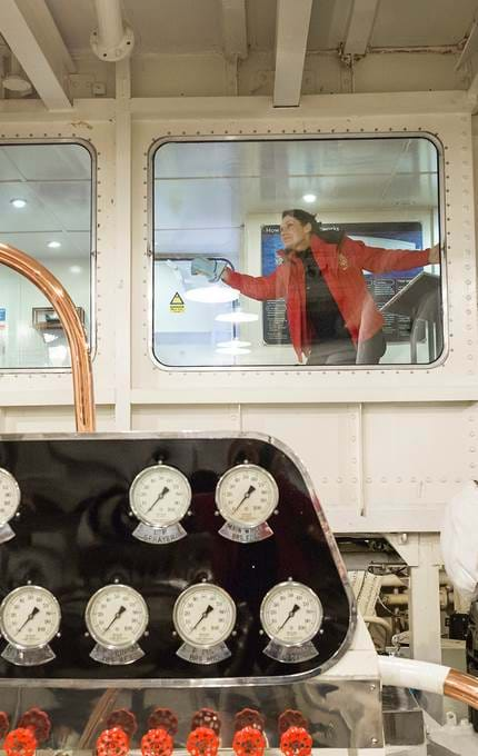 staff cleaning windows in engine rooms royal yacht britannia