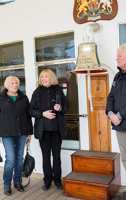 Guide shows visitors our Britannia Bell.