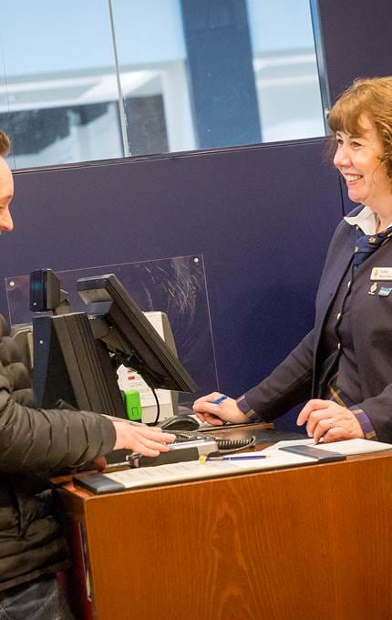 Visitor is welcomes at the ticket desk.