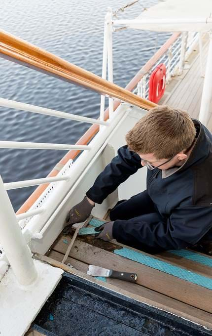 Removing the diamond tread from the starboard access steps to the Royal Deck.