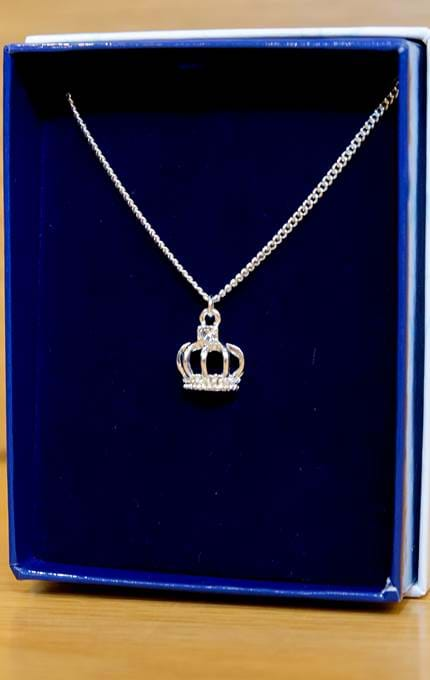 Crown necklace in blue velvet box.