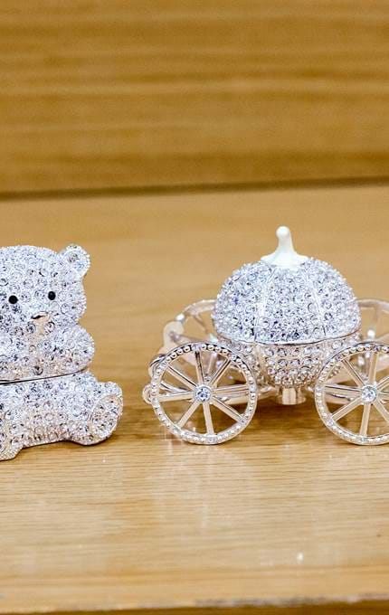 Bear and carriage trinkets.