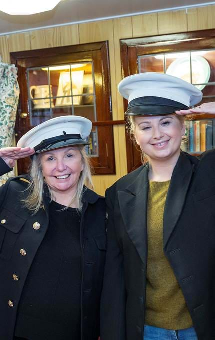 Visitors dress up in sailor's uniforms.
