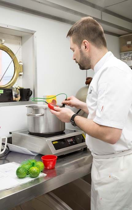 Chef checking the temperature while making pâté de fruits.