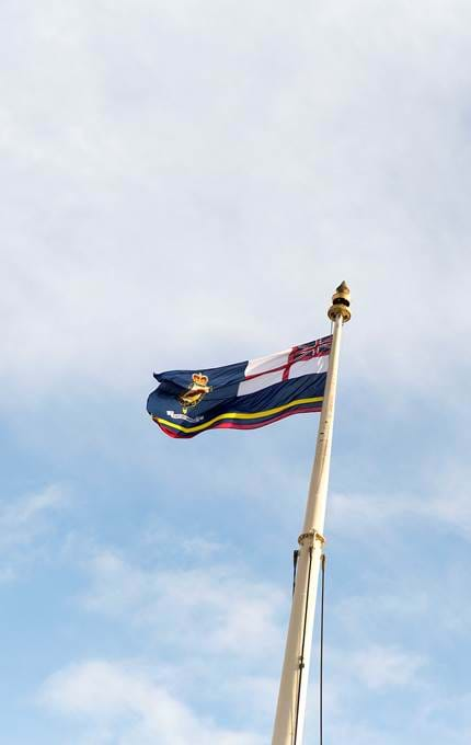 The Royal Yachtsmen Association flag flying high above Britannia.