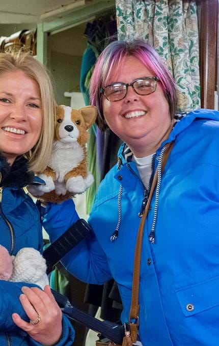 Visitors take picture with corgi toy.
