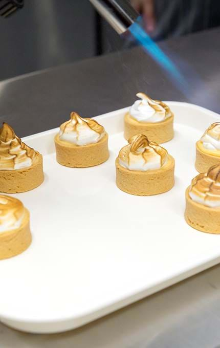 Close up of mini lemon meringue tarts.