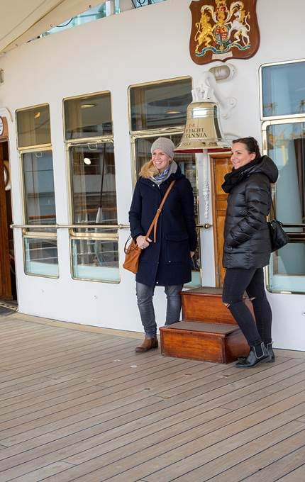 Visitors take picture with Britannia bell.