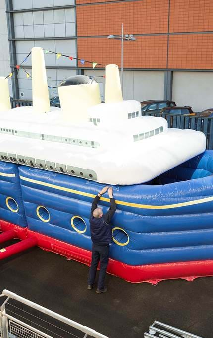 Rigging the inflatable bouncy Britannia.