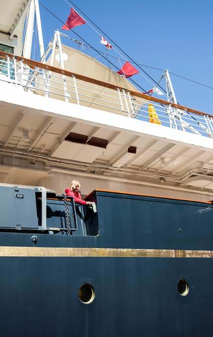 Housekeeper polishes Britannia's hull