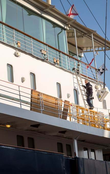 Britannia's upper deck gets painted.